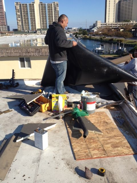 putting new rubber membrance on ocean city roof